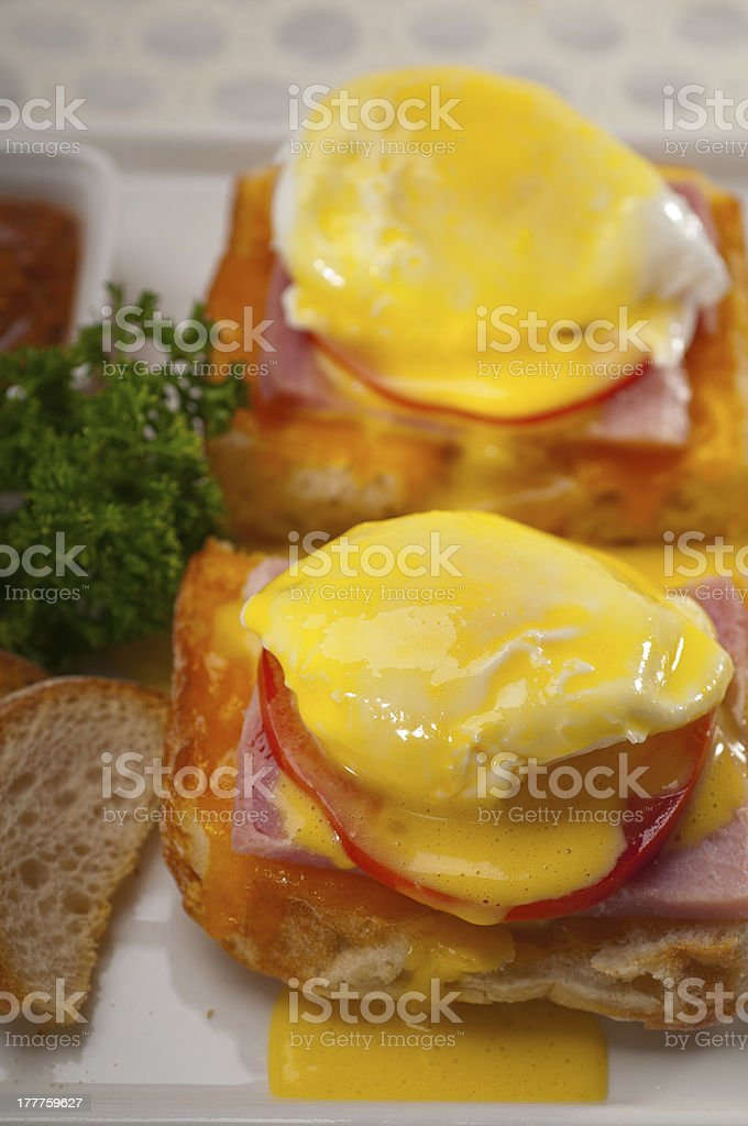 eggs benedict on bread with tomato and ham royalty-free stock photo