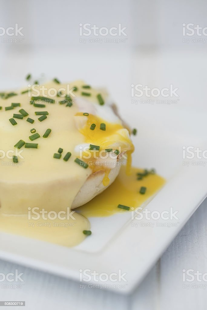 Eggs Benedict toasted English muffins ham poached eggs and holla stock photo