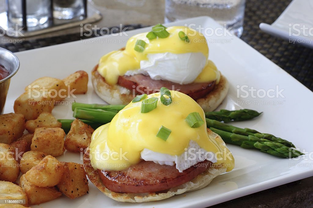 Eggs Benedict with Asparagus and Potatoes stock photo