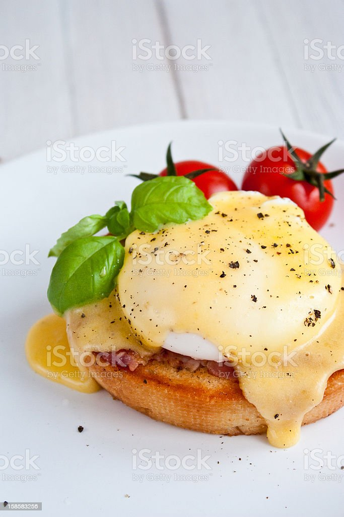 Eggs Benedict with tomatoes and peppers stock photo