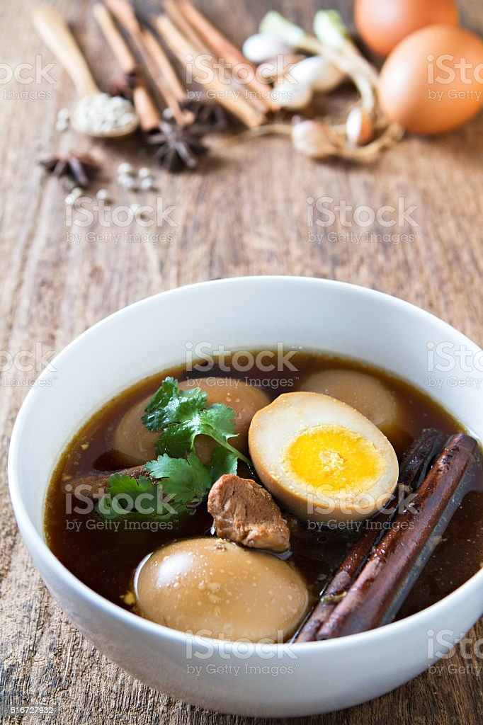 Eggs boiled in the gravy with spices. Thai cuisine. stock photo