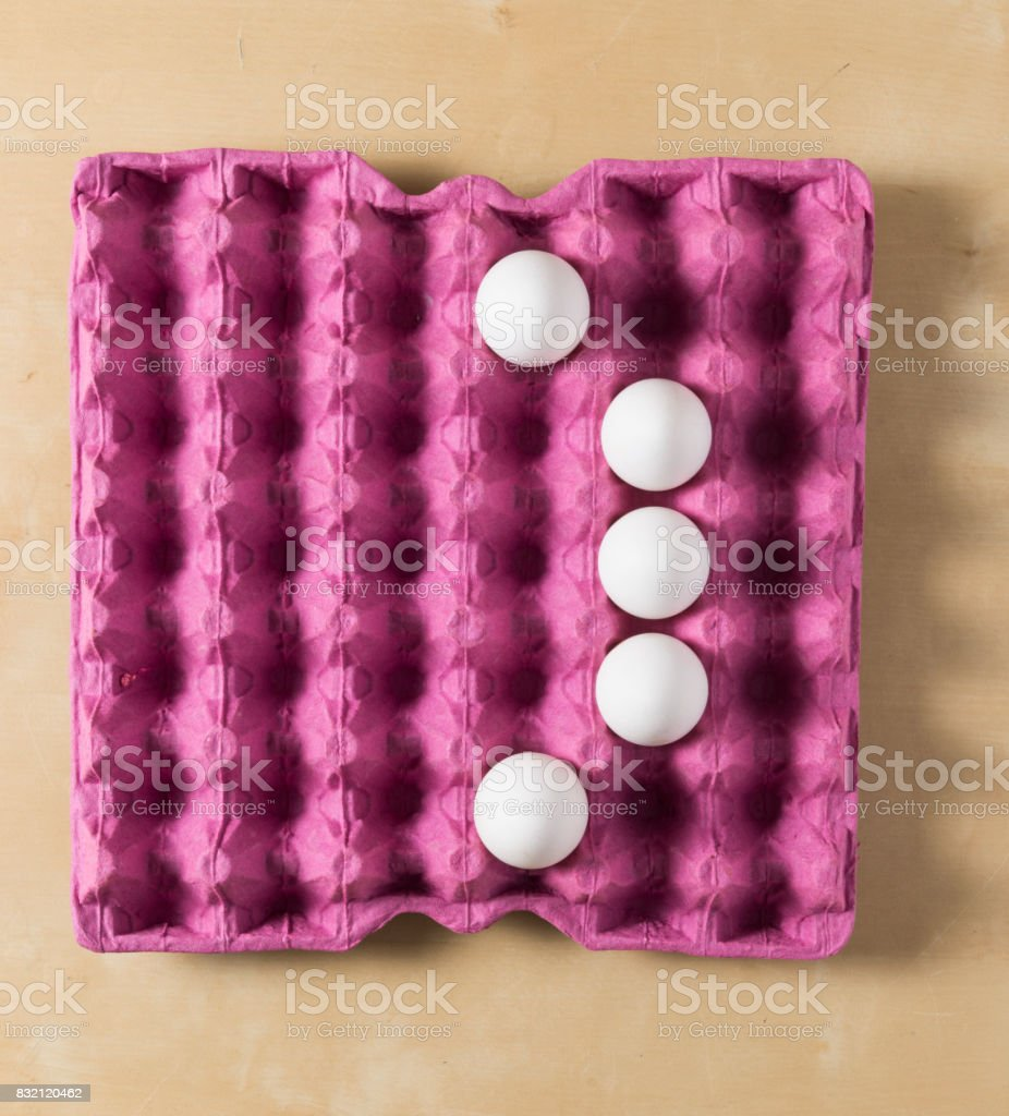 eggs bracket in the paper package tray stock photo