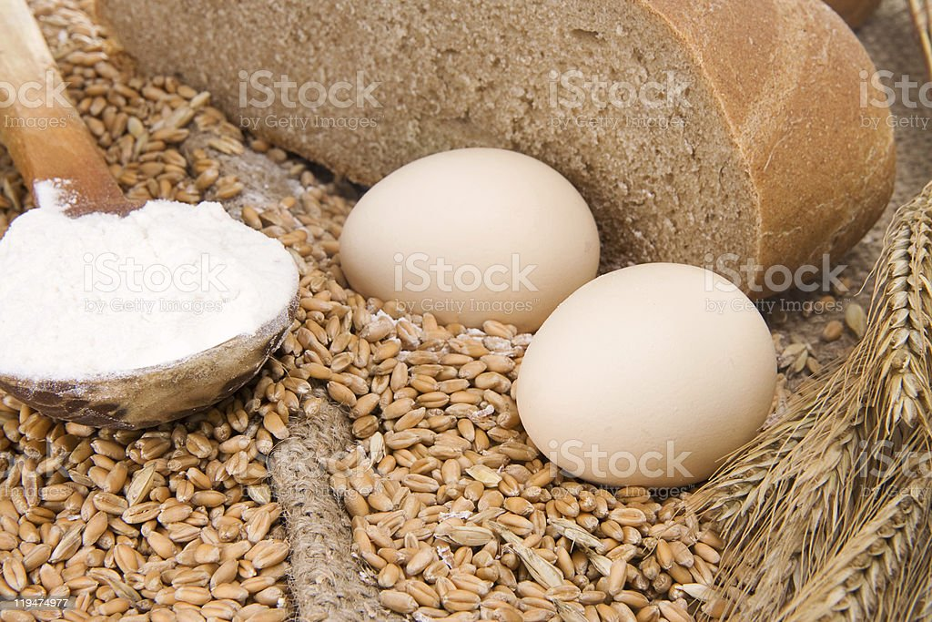 eggs, bread and spoon on sacking royalty-free stock photo