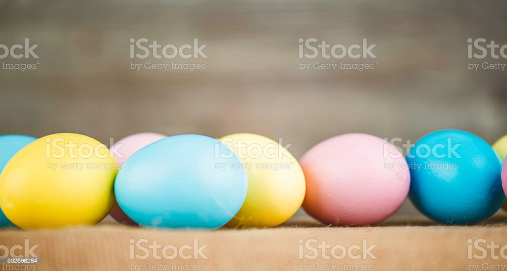 Eggs dyed in pastel colors for Easter with copy space stock photo