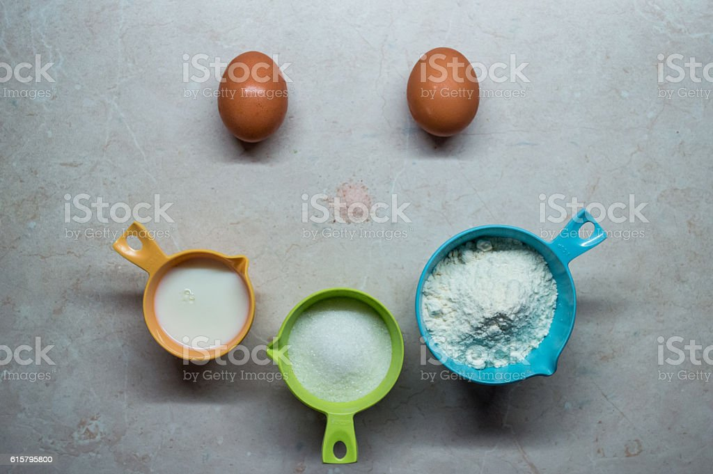 Eggs, Flour, Milk and Sugar/Pancake Ingredients Happy Face royalty-free stock photo