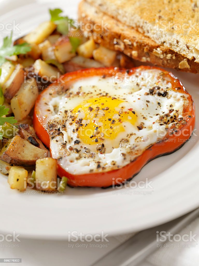 Eggs Fried in Peppers with Hash Browns stock photo