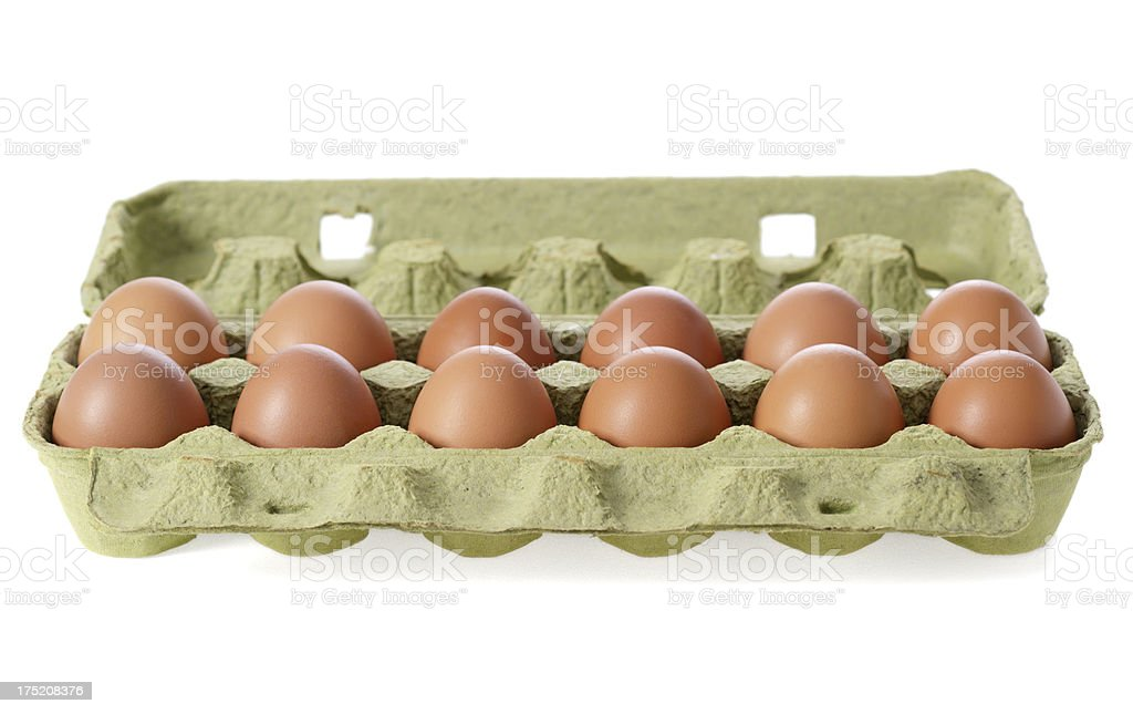 Eggs in a carton on white background stock photo