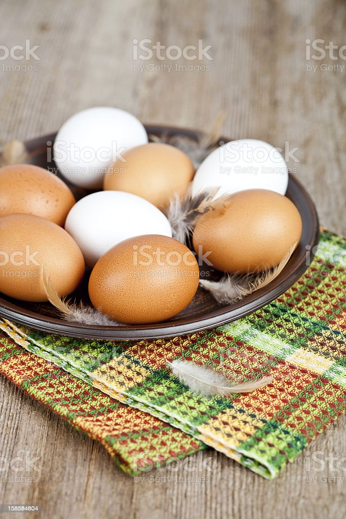 eggs in a plate, towel and feathers royalty-free stock photo