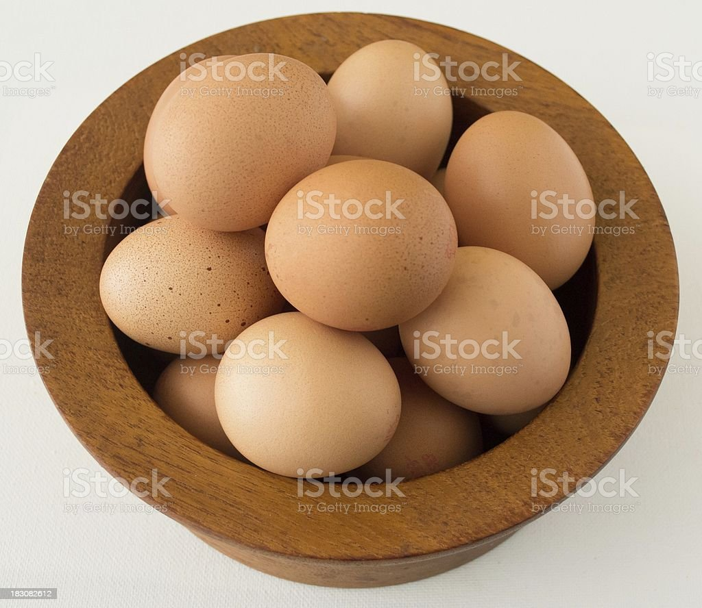 Eggs in a wooden bowl royalty-free stock photo