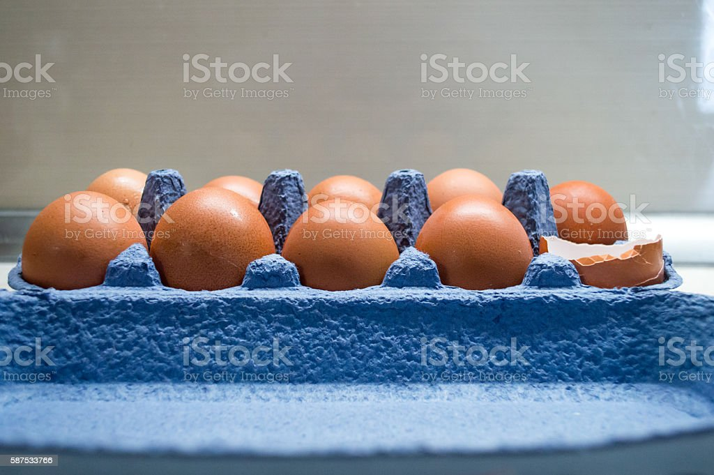 Eggs in an Egg Carton/Box With One Broken Side View stock photo