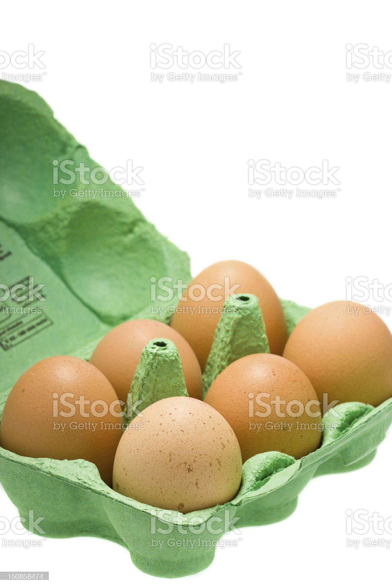 Eggs in carton isolated on white royalty-free stock photo