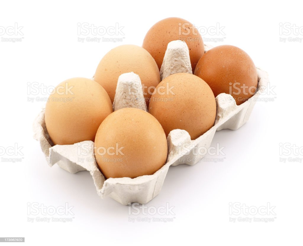 Eggs in carton isolated on white stock photo