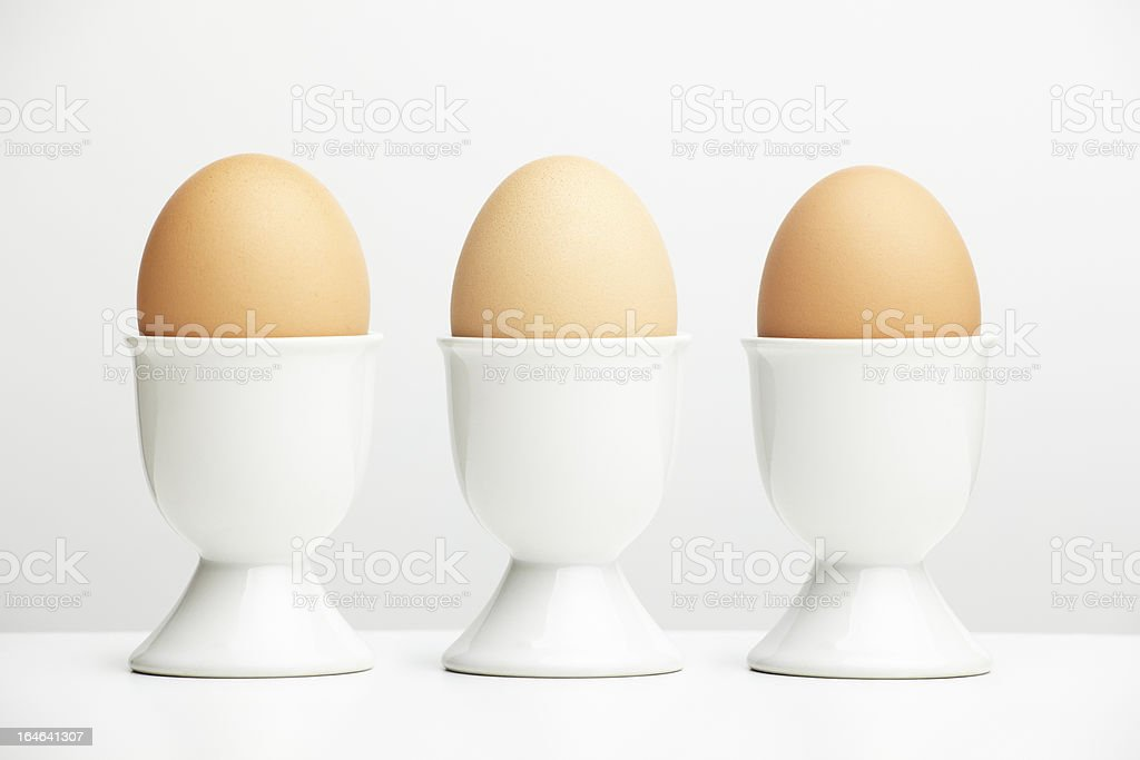 Eggs in egg cups stock photo
