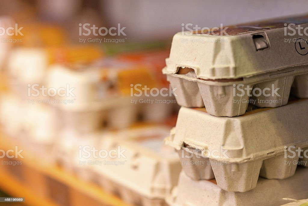 Eggs in store cooler stock photo