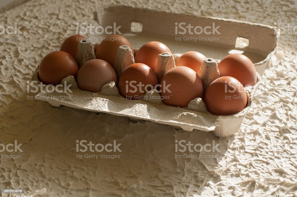 Eggs in the package white on table stock photo