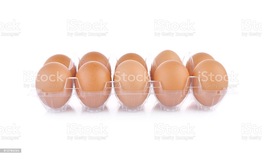 eggs in transparent tray package on white background stock photo