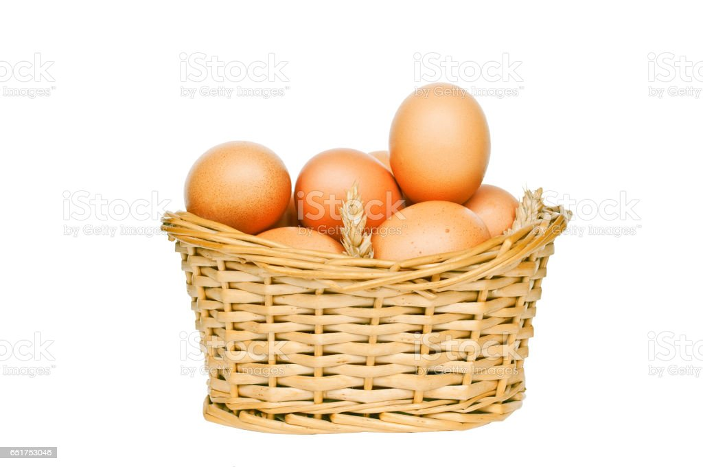 Eggs in wicker basket isolated on white stock photo