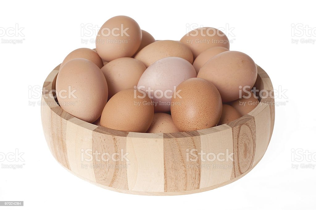 eggs in wooden bowl stock photo
