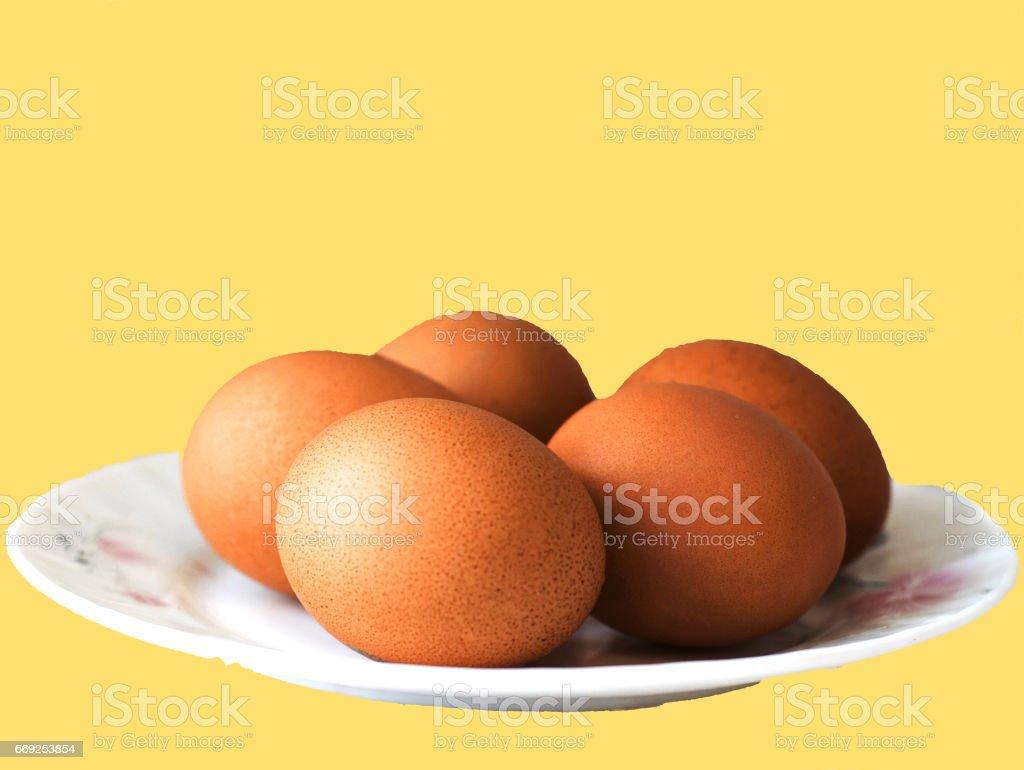 Eggs lie on a saucer stock photo