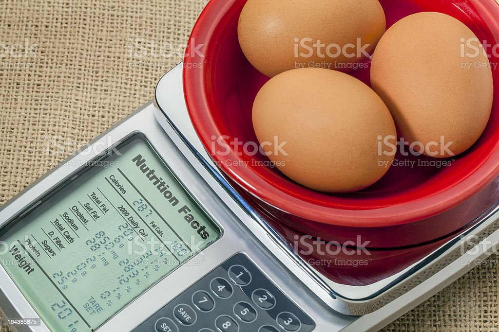 eggs on diet scale royalty-free stock photo