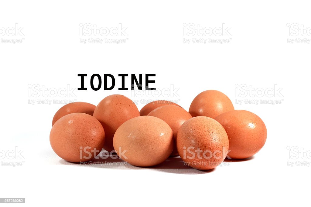 Eggs on white background with Iodine text. stock photo