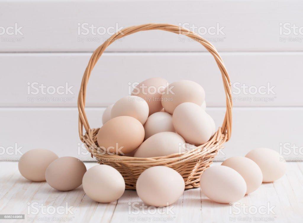 eggs on white wooden background stock photo