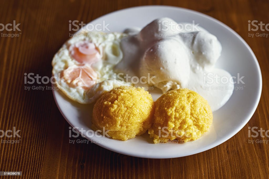 eggs, polenta and cream stock photo