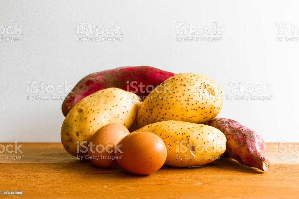 Eggs, potato and yams stock photo