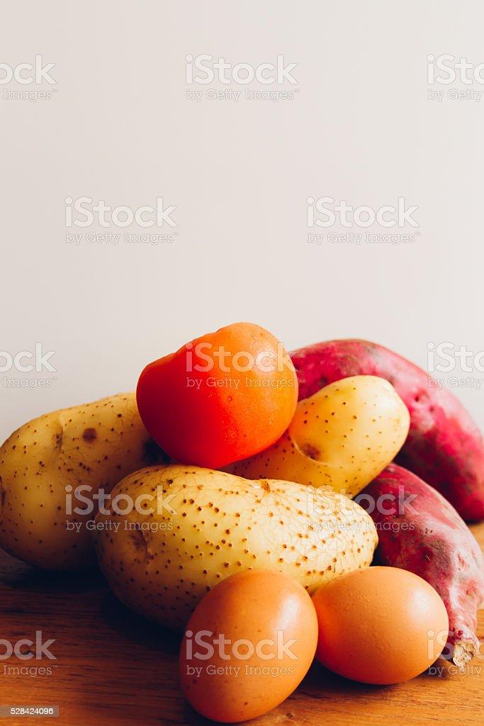Eggs, potatos, yams and tomato stock photo