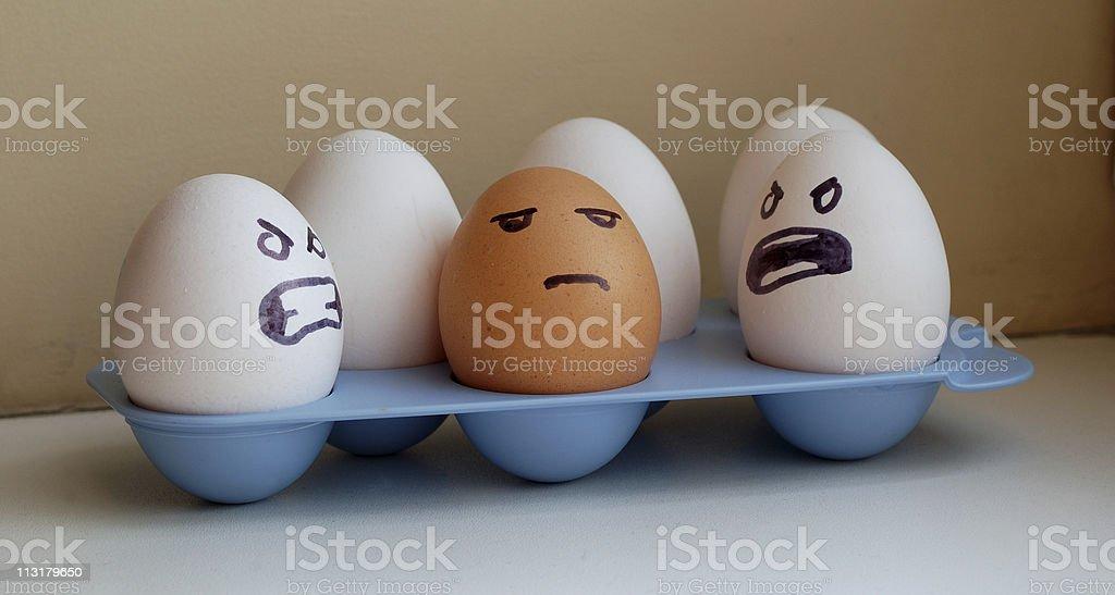 Eggs racism stock photo