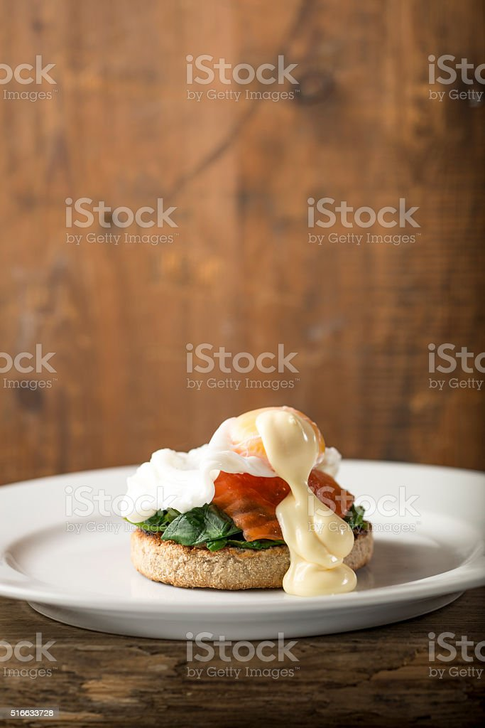 Eggs Royale with Smoked Trout and Spinach stock photo