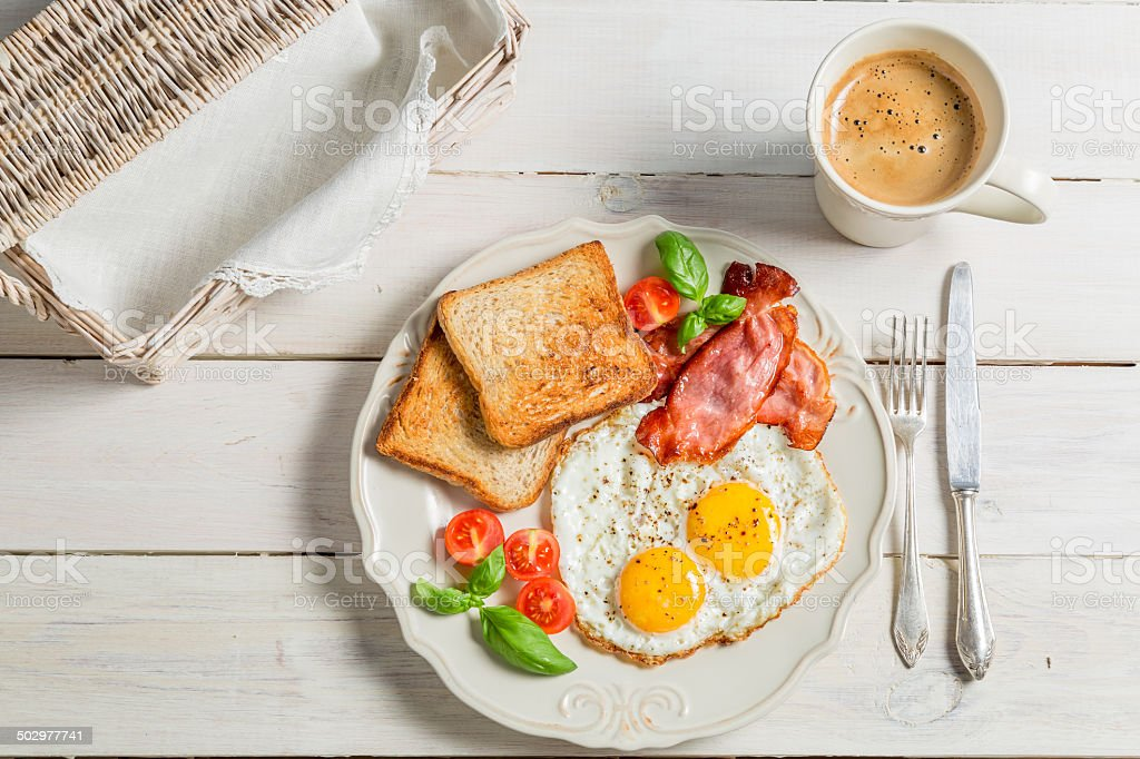 Eggs, toast and bacon for breakfast stock photo