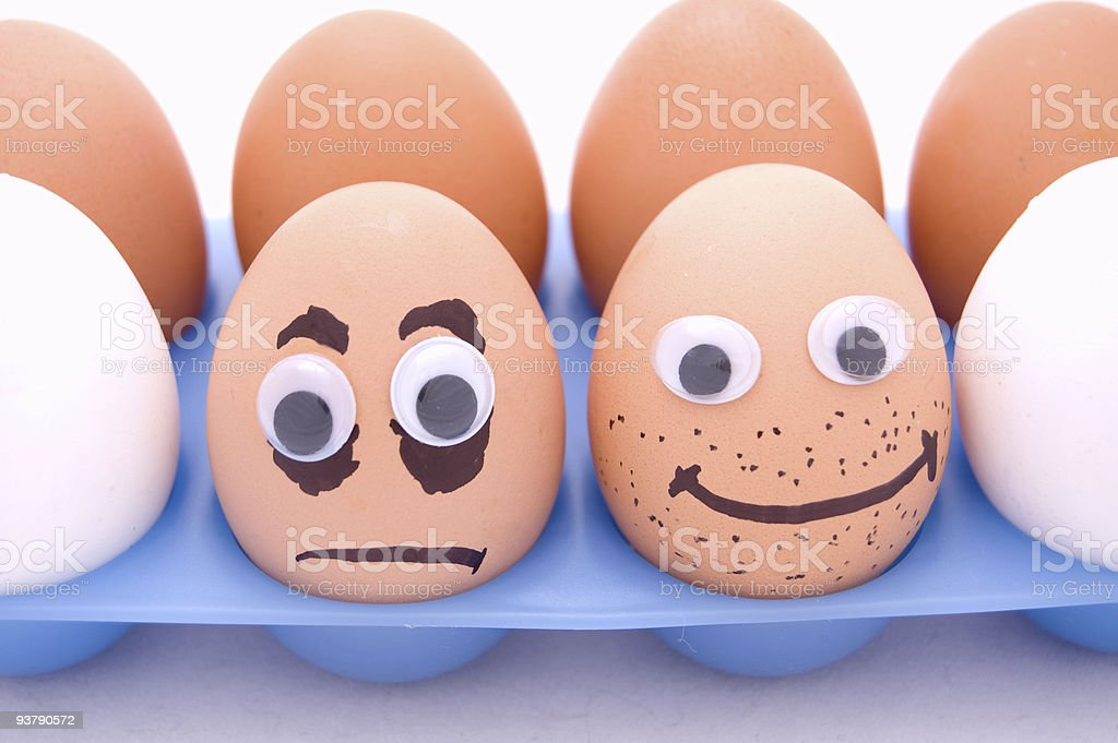 eggs with eyes and smiles stock photo