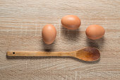 Eggs  with  wooden spoon on wood table