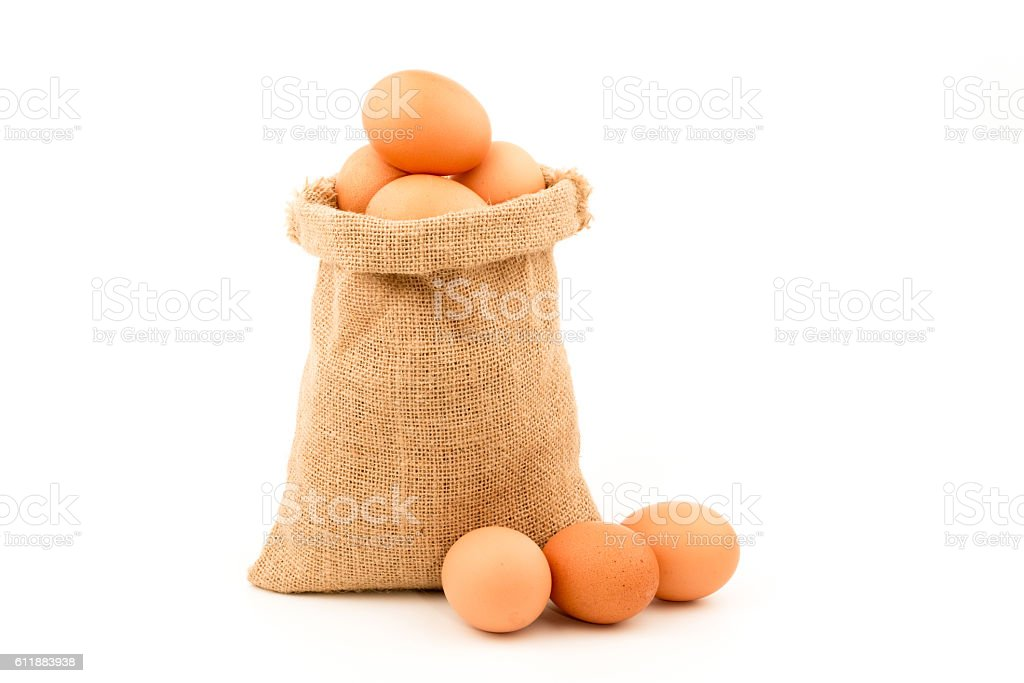 Eggs wrapped in sackcloth isolated on white background stock photo