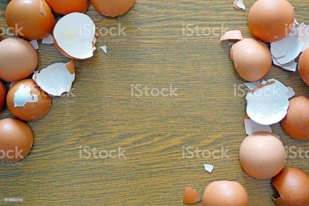 Eggshell on a wooden backdrop stock photo