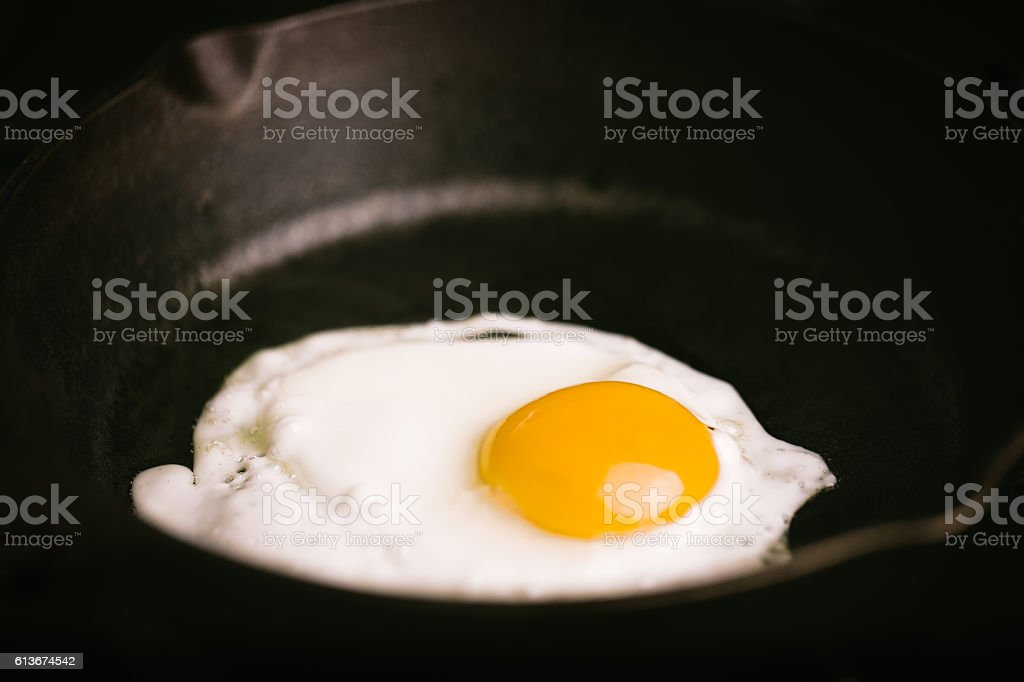 Egg-sunny side up on skillet stock photo