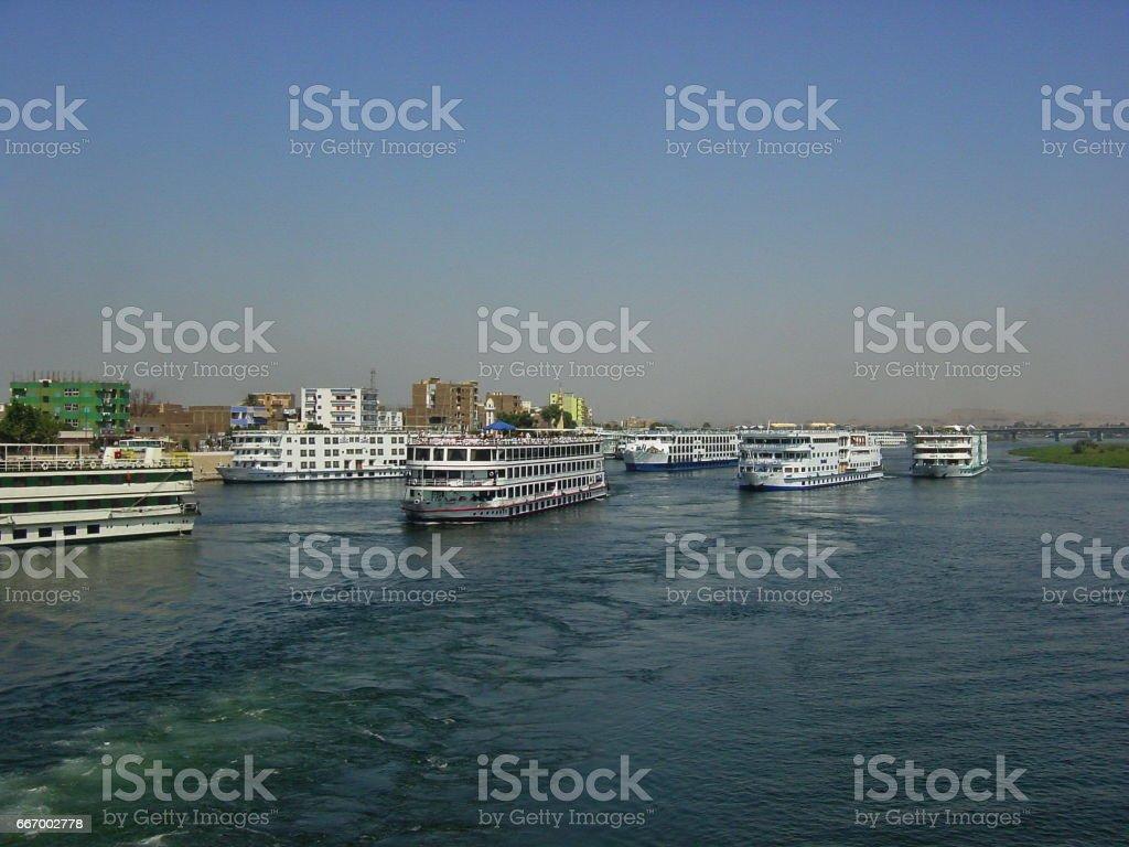 Egypt Edfu. Nile Cruises are waiting for Horus Temple tourists. stock photo
