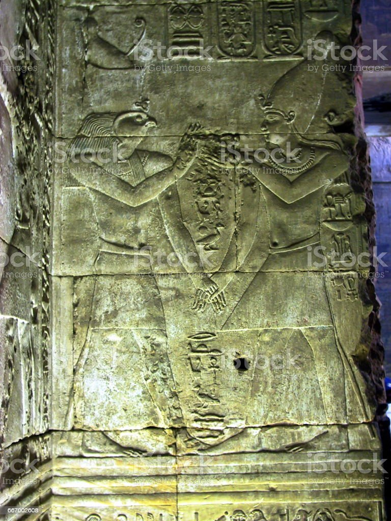Egypt Edfu. Ptolemaic Temple Of Horus. Ramses and Horus Reliefs. stock photo