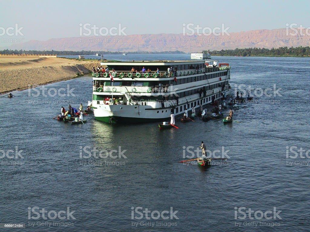 Egypt Esna. Nile Cruises surrounded by  floting market. stock photo