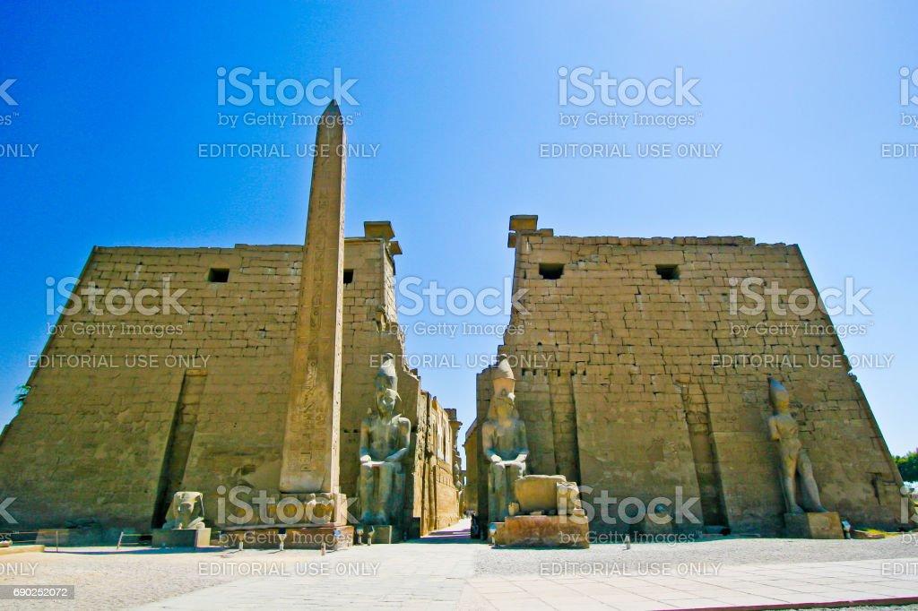Egypt Luxor. Temple entrance Pylon with obelisk at dawn stock photo