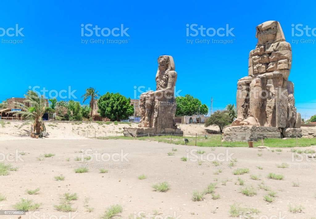 Egypt. Luxor. The Colossi of Memnon - two massive stone statues of Pharaoh Amenhotep III stock photo