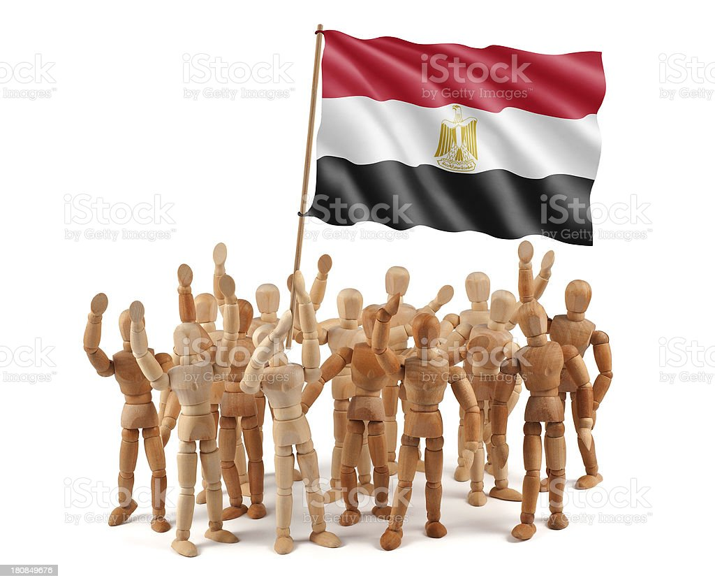 Egypt - wooden mannequin group with flag stock photo