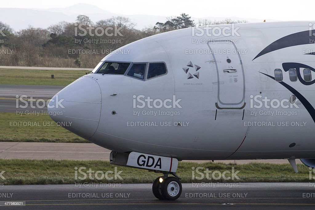 Egyptair Boeing 737 arrives to Manchester Airport royalty-free stock photo