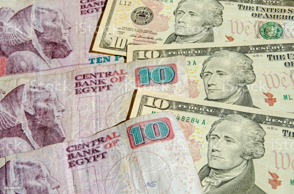 Egyptian and US banknotes stock photo