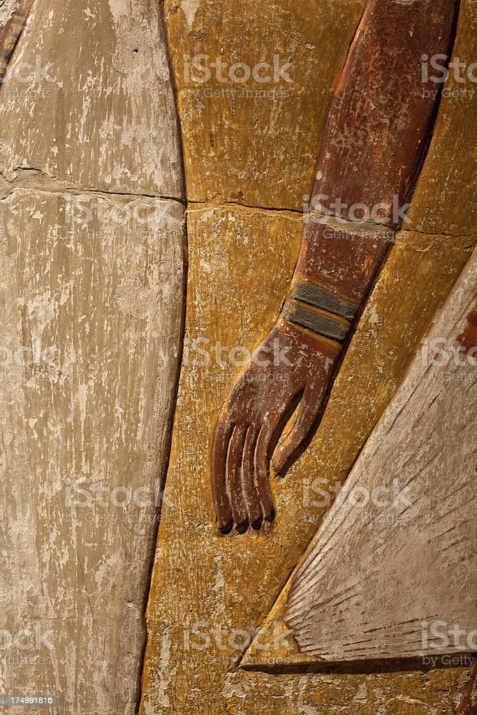 Egyptian art: close up of painted hand carved in stone royalty-free stock photo