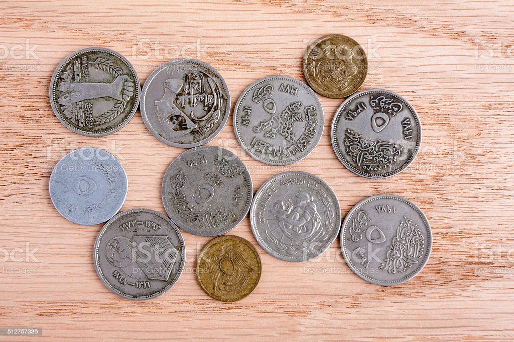 Egyptian coins on wooden background stock photo