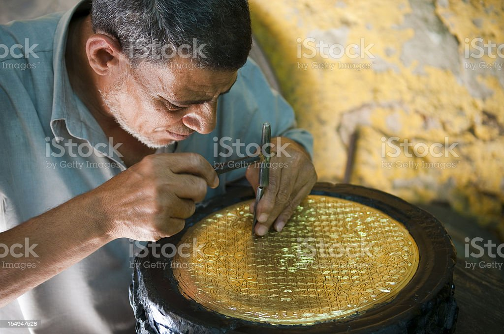 Egyptian craftsman at work in Cairo, Egypt stock photo