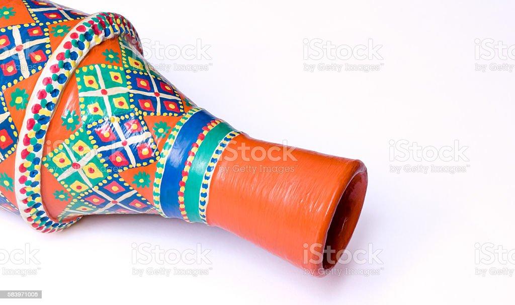 Egyptian decorated orange pottery vase on white background stock photo