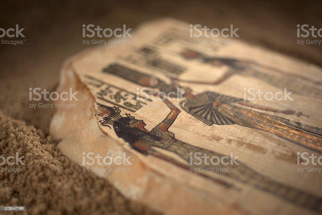 Egyptian Hieroglyph Stone Tablet in Sand stock photo